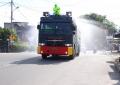 Polres Karimun Gunakan Water Canon, Semprotkan Disinfektan di Jalur Protokol